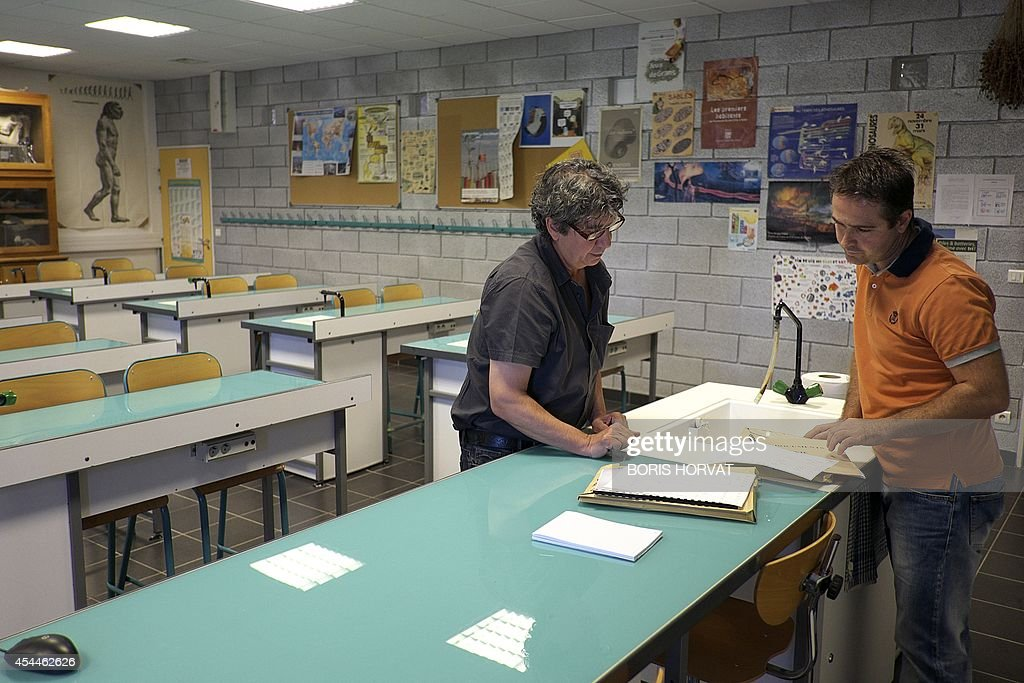 Natural sciences' teacher at the college du Roy d'Espagne prepares their school year in Marseille, southern France, on September 1, 2014, on the eve of the new school year.