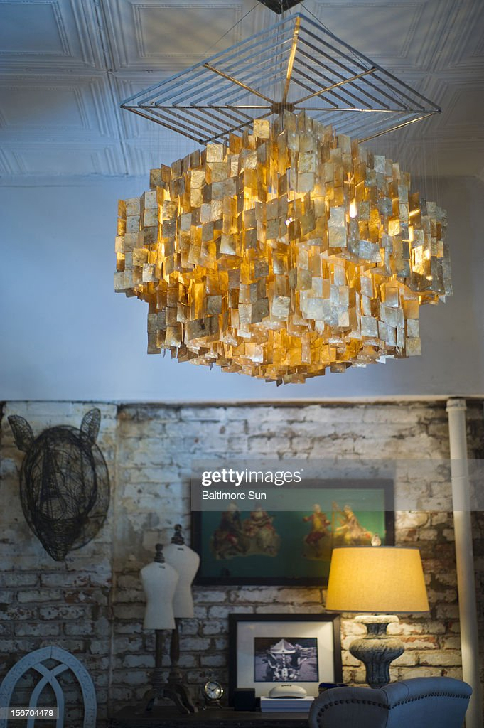 A natural shell chandelier in the bedroom of Christian Siriano's New York City apartment is featured, September 11, 2012.