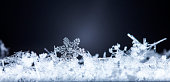 winter card, photo real snowflakes on snow
