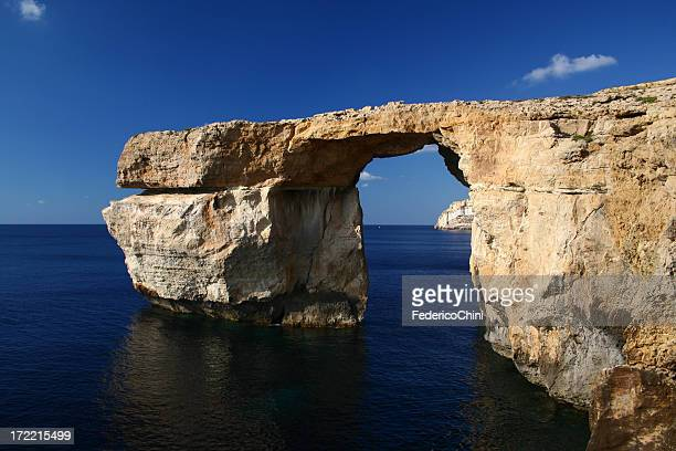 A natural stone archway in the ocean
