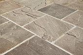 Stone paving on a garden patio area.