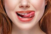 natural tongue open mouth. Studio shot.