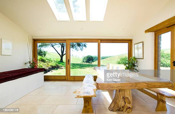 Natural wood benches and table in modern dining room