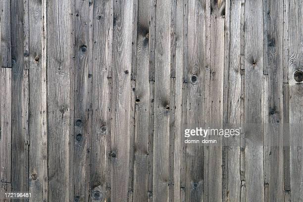 自然の木製の背景に、フェンスで作られた木製のグレイの縦 planks