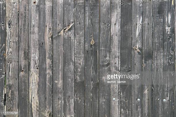 Fond en bois, clôture fait de planches en bois gris vertical