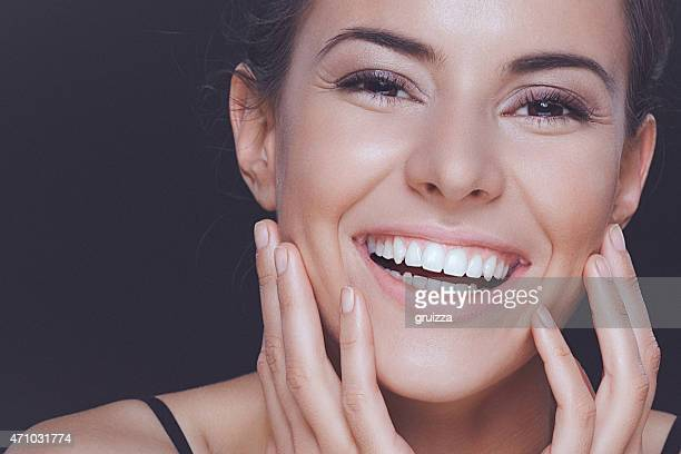 Natural young woman with perfect smile and clean healthy skin