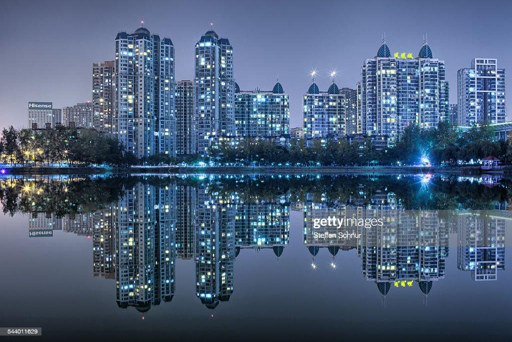 Nature and city mirrored skyline at sea China