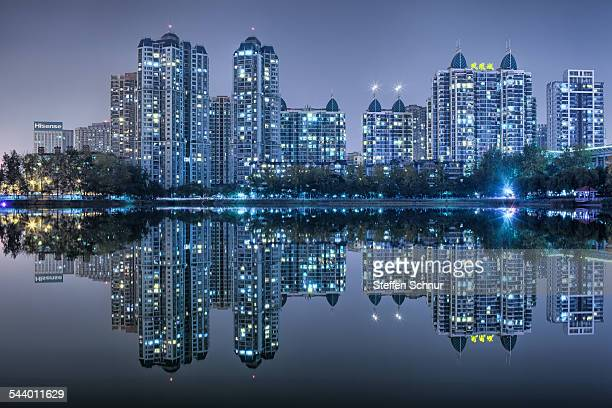 Nature and city mirrored skyline at sea China
