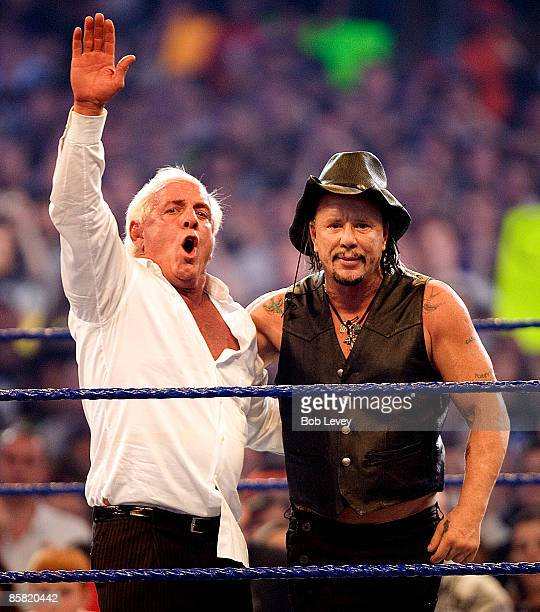 Nature Boy Ric Flair and actor Mickey Rourke wave to the crowd at 'WrestleMania 25' at the Reliant Stadium on April 5 2009 in Houston Texas