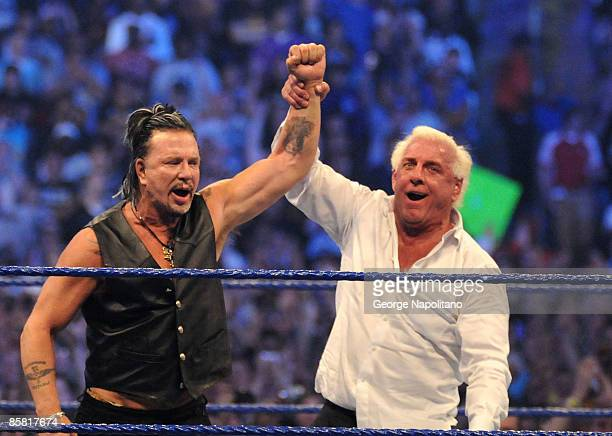 'Nature Boy' Ric Flair raises the arm of actor Mickey Rourke after he knocked out Chris Jericho at WrestleMania 25 at the Reliant Stadium on April 5...
