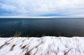 Coastal cliffs near Paldiski city in Estonia forming Estonian flag in the nature.