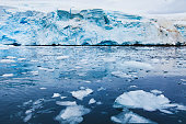 iceberg melting in Antarctica, beautiful nature landscape with glacier and ice in water, global warming