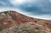 Nature photographer in amazing striped red mountains
