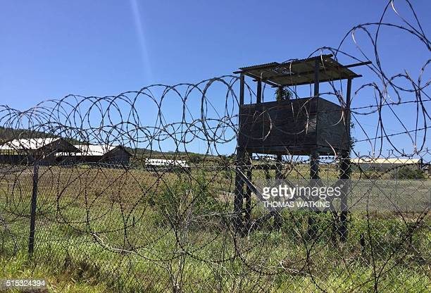 Nature reclaims the US militarys Camp XRay at Guantanamo Bay Naval base on March 9 in Guantanamo Bay Cuba The infamous holding center closed 14 years...