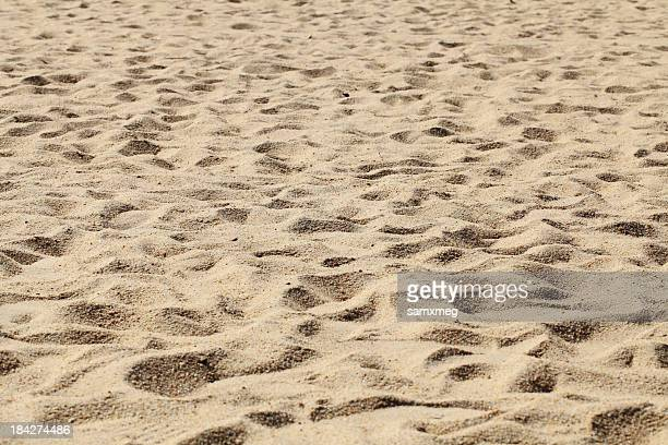 Nature shot of beige sand with footprints
