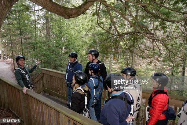 A nature trail guide talking to a group on the Forest Canopy Bridge at the Historic Mill Creek Discovery Park