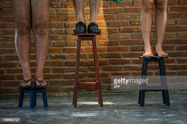 Naturists stand on chairs as they receive medals during the first Brazilian Naturist Olympics in Guaratingueta about 200 km east of Sao Paulo Brazil...