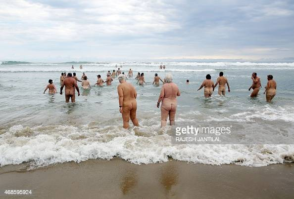 Naturists take a swim during the Easter weekend at the Mpenjati beach some 155 kilometres south of Durban on April 04 2015 At the end of October 2014...