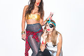 Naughty female friends poke fun at each other on masquerade