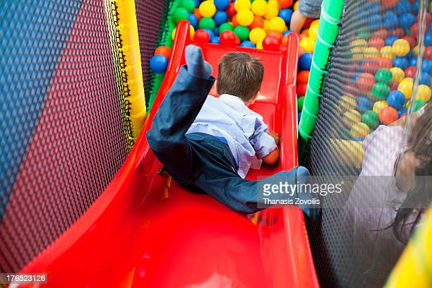 Naughty kid playing in the playground