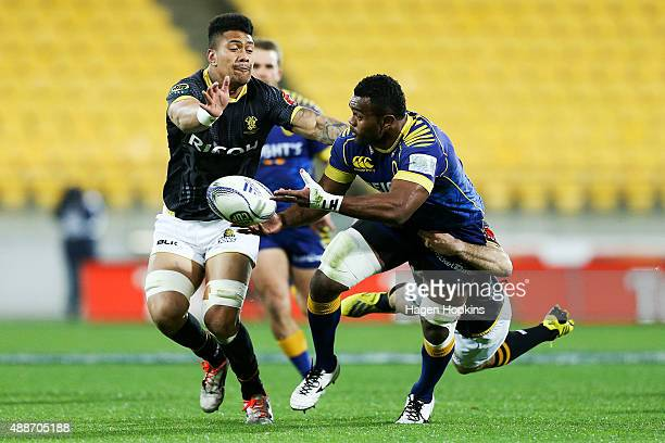 Naulia Dawai of Otago offloads in the tackle of Jonny Bentley of Wellington while Ardie Savea looks on during the round six ITM Cup match between...