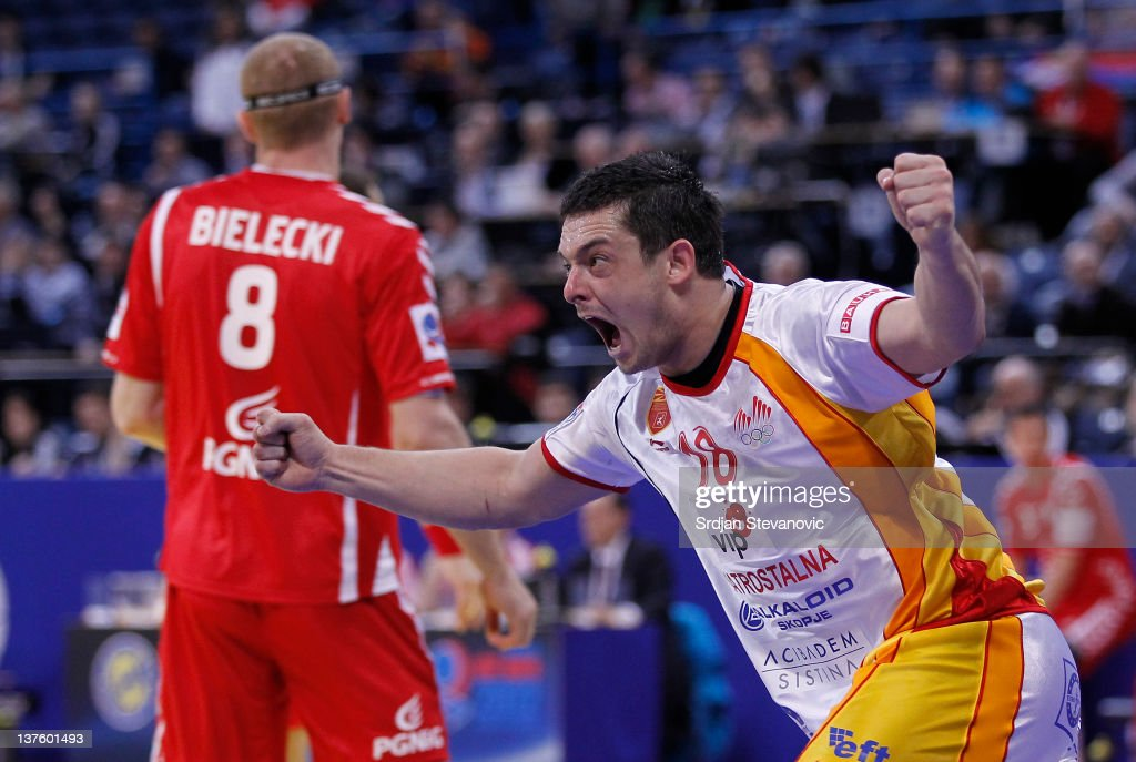Naumche Mojsovski (R) of Macedonia celebrates scoring past <a gi-track='captionPersonalityLinkClicked' href=/galleries/search?phrase=Karol+Bielecki&family=editorial&specificpeople=786154 ng-click='$event.stopPropagation()'>Karol Bielecki</a> (L) of Poland during the Men's European Handball Championship 2012 second round group one match between Poland and Macedonia, at Arena Hall on January 23, 2012 in Belgrade, Serbia.