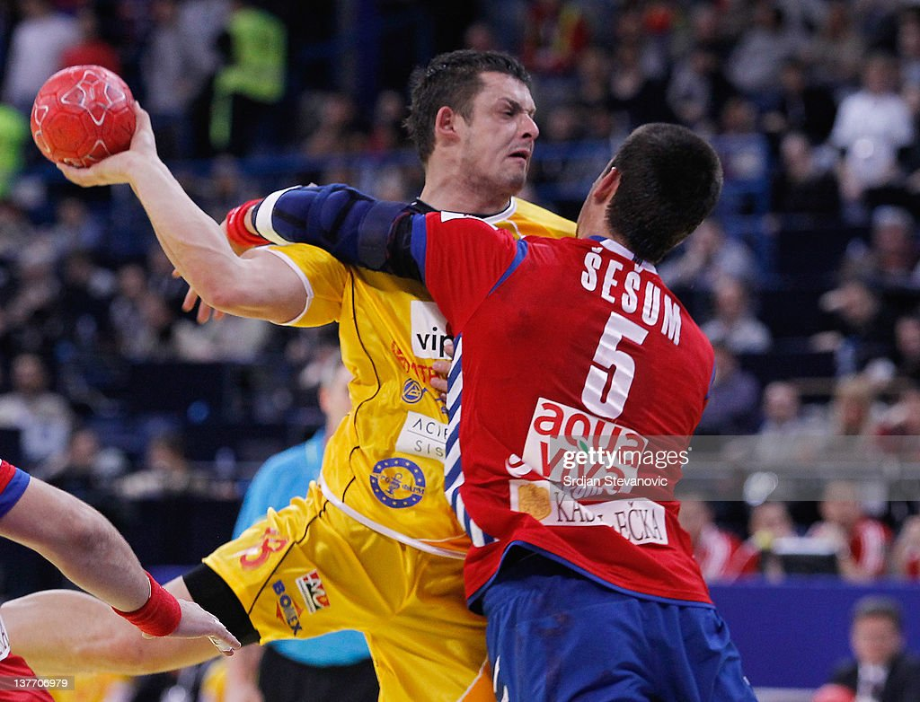 Naumche Mojsovski (L) vies with Zarko Sesum (R) of Serbia during the Men's European Handball Championship 2012 second round group one match between Serbia and Macedonia at Arena Hall on January 25, 2012 in Belgrade, Serbia.