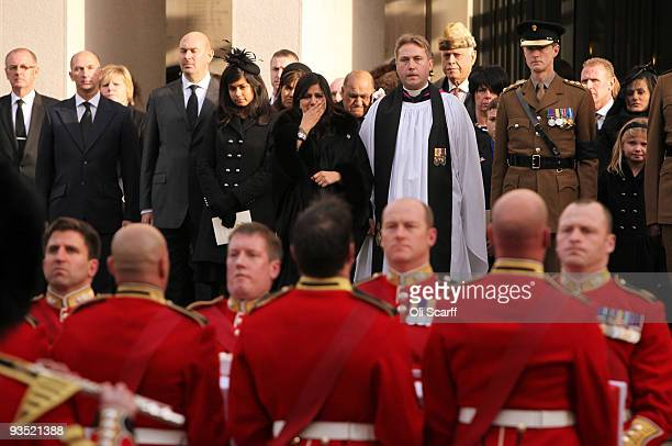 Nausheen Chant the wife of Warrant Officer Darren Chant grieves as her husband's coffin is carried out of the Guards Chapel on the Wellington...