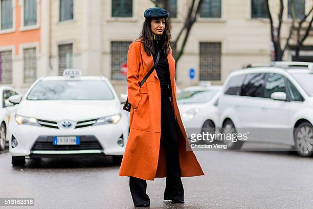 Nausheen Shah is wearing a orange leather coat from MSGM and a Dolce Gabbana hat seen outside Giorgio Armani during Milan Fashion Week Fall/Winter...
