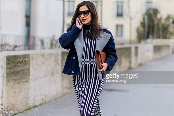 Nausheen Shah is wearing a striped dress and navy jacket outside Ellery during the Paris Fashion Week Womenswear Fall/Winter 2016/2017 on March 8...