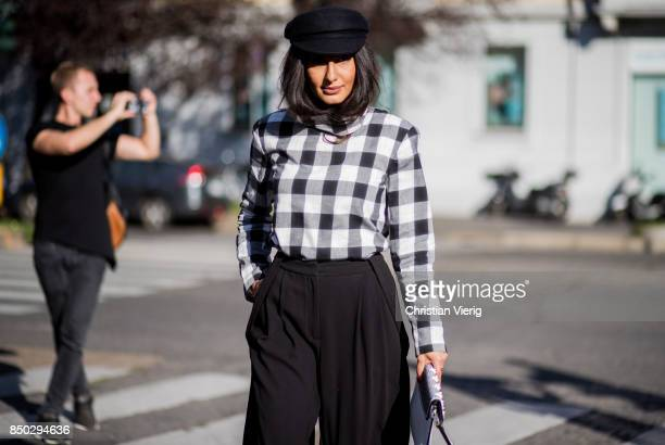 Nausheen Shah wearing a checked top flat cap is seen outside Alberta Ferretti during Milan Fashion Week Spring/Summer 2018 on September 20 2017 in...