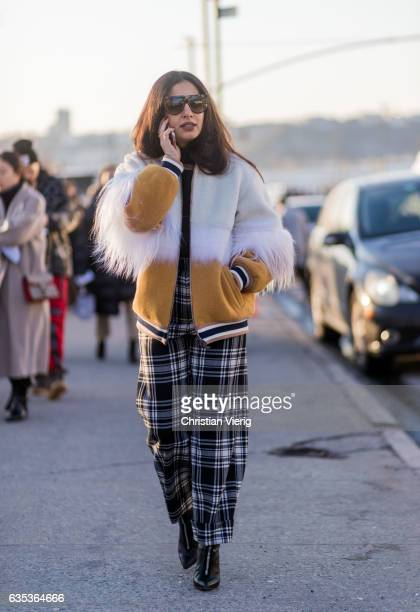 Nausheen Shah wearing black white checked pants white college jacket outside Coach on February 14 2017 in New York City