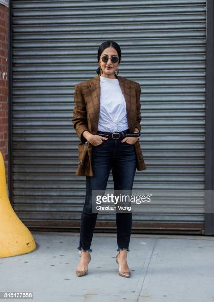 Nausheen Shah wearing brown checked blazer jacket denim jeans earings seen in the streets of Manhattan outside Diane von Furstenberg during New York...