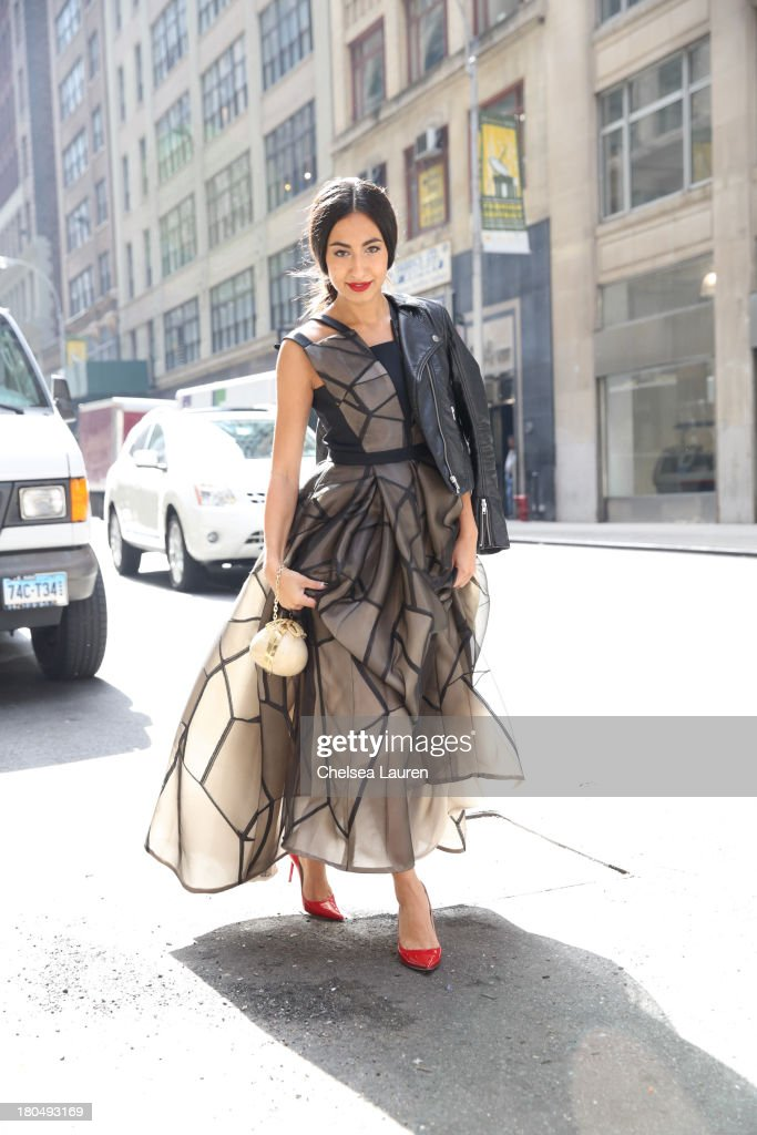 LOOK #18. Nausheen Shah, writer and stylist working with MarieClaire.com and the New York Post, wears a Bibhu Mohapatra Spring 2014 onyx fracture organza jacquard dress with inverted pleats, with a vintage leather jacket, Jimmy Choo shoes, and an Aranaz bag from L'Atitude on the streets of Manhattan's garment district on September 13, 2013 in New York City.