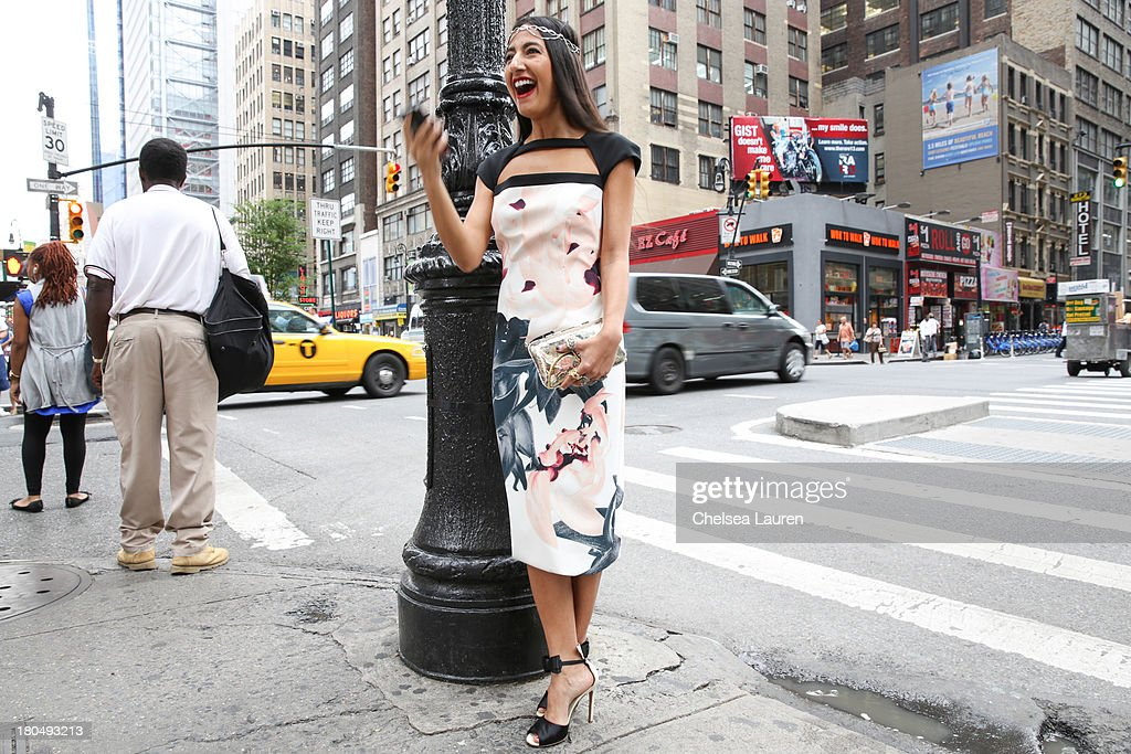 LOOK #13. Nausheen Shah, writer and stylist working with MarieClaire.com and the New York Post, wears a Bibhu Mohapatra Spring 2014 blush and black palash flower print ponte day dress, with an Ana Khouri tiara, Gianvito Rossi shoes, and a Anndra Neen bag on the streets of Manhattan's garment district on September 13, 2013 in New York City.