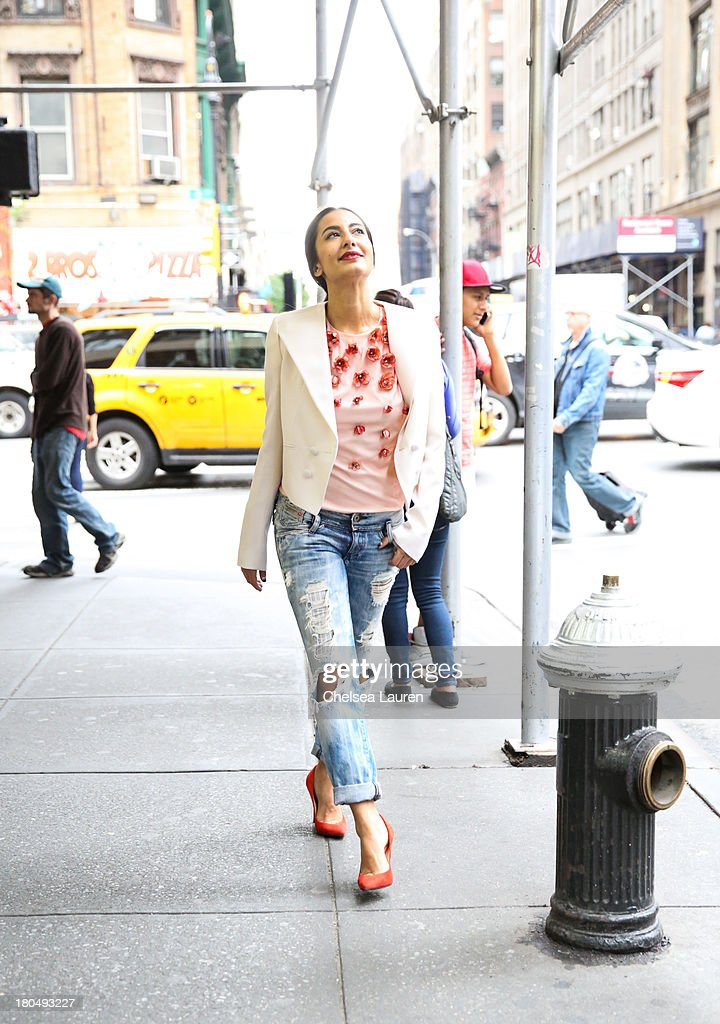 LOOK #7. Nausheen Shah, writer and stylist working with MarieClaire.com and the New York Post, wears a Bibhu Mohapatra Spring 2014 coral baby tulip tulle top, with a Givenchy blazer, Diesel jeans and Giuseppe Zanotti shoes on the streets of Manhattan's garment district on September 13, 2013 in New York City.