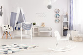 Spacious nautical baby style interior with white furniture