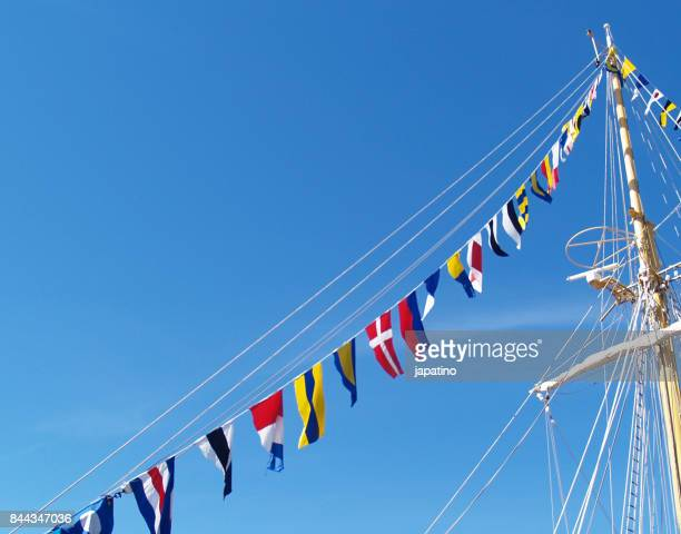Nautical flags decorating the main mast of a ship