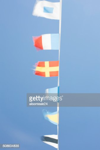 Nautical flags on a boat fluttering, Cannes, France : Stock Photo