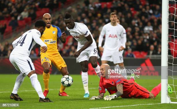 Nauzet Perez of Apoel FC makes a save from GeorgesKevin Nkoudou of Tottenham Hotspur and Davinson Sanchez of Tottenham Hotspur during the UEFA...