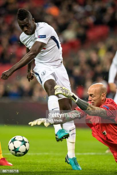 Nauzet Perez of APOEL Nicosia saves at the feet of Davinson Sanchez of Tottenham Hotspur during the UEFA Champions League group H match between...