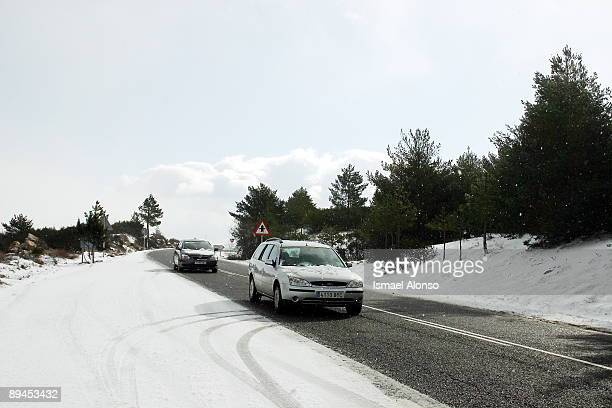 Navacerrada mountain pass road covered with snow after the storm