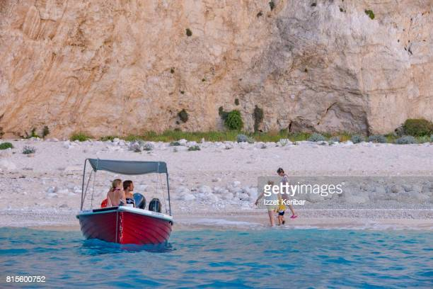 Navagio beach also known as shipwreck beach, red boat, sandy beach and bare cliff in the background, Zakynthos, Ionian island