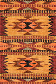 Navajo woven wool blanket rug design. The Navajo stained their yarns for fabrics using natural items from the surroundings - beige from corn silk, tan from brown onion skin, maroon from Juniper bark,
