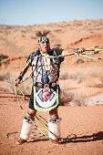 A Navajo Native American Man performs traditional hoop dance (horizontal)