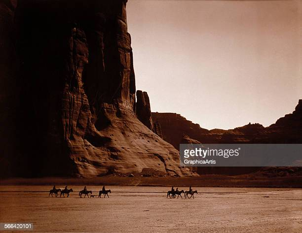Navajo Riders in Canyon de Chelly by Edward S Curtis sepiatoned photograph circa 1904