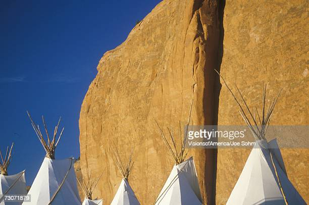 'Navajo teepees against cliff, Gallup, NM'