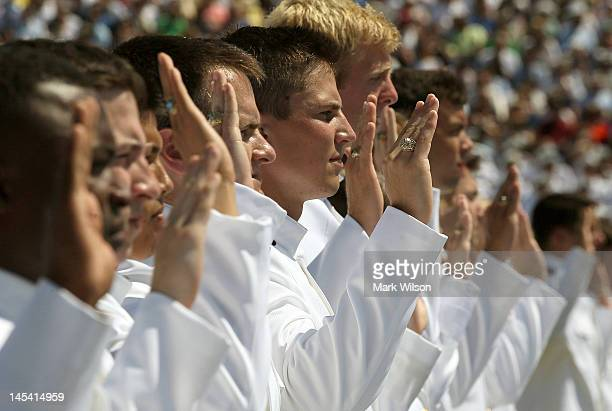 S Naval Academy cadets take their oath during graduation ceremonies at the US Naval Academy May 29 2012 in Annapolis Maryland US Secretary of Defense...