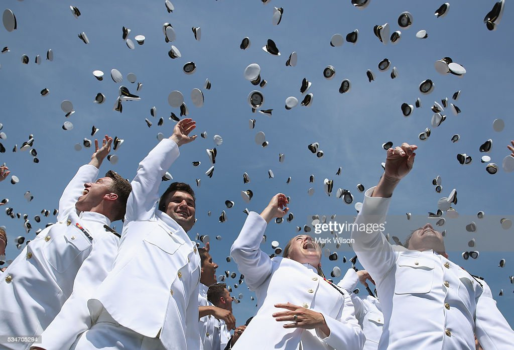 U.S. Naval Academy graduates toss their hats in the air during graduation ceremonies at the U.S. Naval Academy May 27, 2016 in Annapolis, Maryland. This is the first year that females wore the same uniform as the males. U.S. Secretary of Defense Ashton Carter was this year's commencement speaker.
