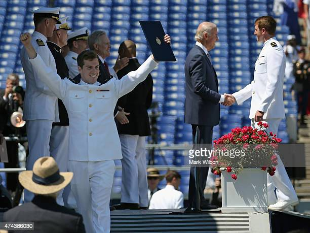 S Naval Academy Midshipmen 1st Class celebrates after receiving his diploma from US Vice President Joe Biden during graduation ceremonies at the US...